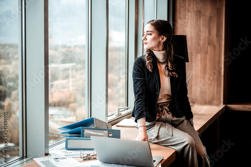 Fotografie, Obraz  Relaxed longhaired female person looking at window