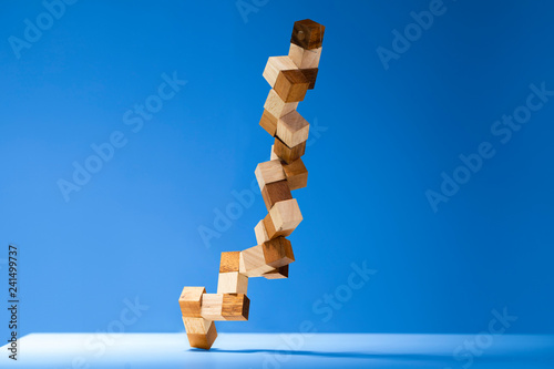 Valokuva  Snake cube Wooden puzzle isolated on color backgrounds