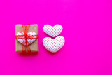 Valentine's heart with gift box  on pink background.