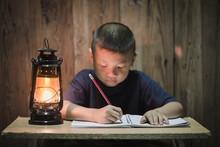 Poor Children Write Books Illuminating With Oil Lamps, Disadvantaged Children Doing Homework, Education Concept.