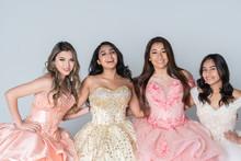 Four Hispanic Girls In Quincea...