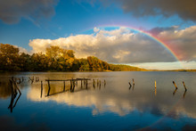 Rainbow Over The Lake On An Autumn Evening