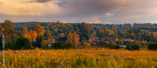 village surrounded by autumn forest-panorama Canvas Print