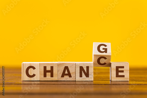 Photographie  Change concept. Wooden letters on a yellow background