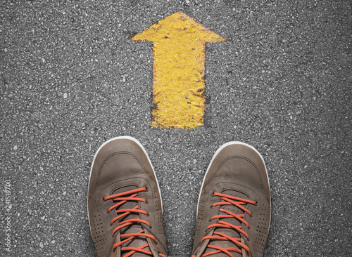 yellow arrow pointing ahead direction concept Canvas Print