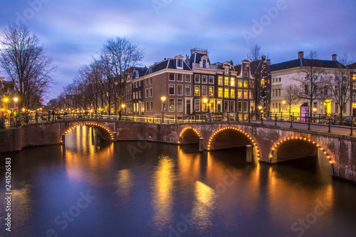 Fotografija View on romantic canal Leidsegracht in Amsterdam at night with city lights, brid