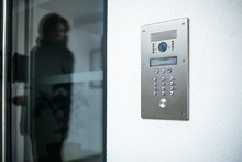 Woman Silhouette Preparing To Enter Modern Luxury Home With Focus On The Door Digital Interphone