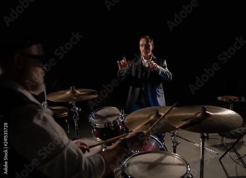 In de dag Muziekband conductor and drummer