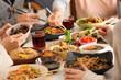 Leinwandbild Motiv Friends eating tasty Chinese food at table