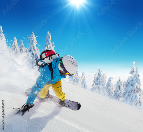 Young man skiing on piste