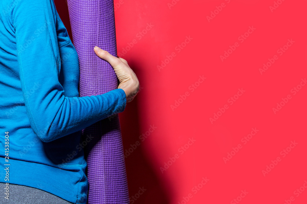 Fototapety, obrazy: Sporty yoga girl with yoga mat isolated over bright background
