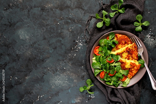 Garden Poster Personal Homemade omelette with potato served with salad on dark background. Potatoes tortilla - traditional Spanish dish. Top view with copy space. Healthy food concept.