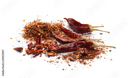 Dry spicy chili peppers and flakes, powder isolated on white background