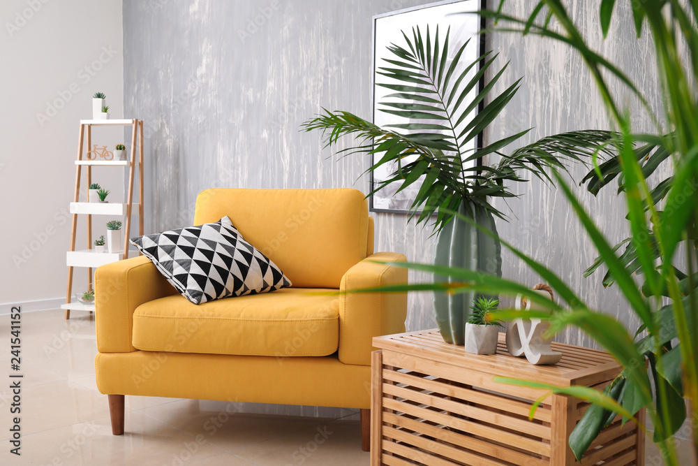 Fototapety, obrazy: Green tropical leaves in interior of living room