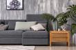 Leinwanddruck Bild - Stylish interior of living room with comfortable grey sofa