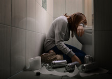 Young Vomiting Woman Near Toilet Bowl. Concept Of Alcoholism