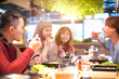 canvas print picture - happy asian young Group  eating in the restaurant