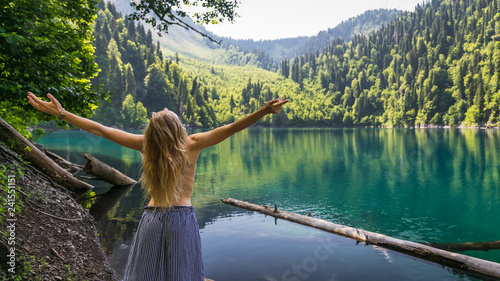 Photographie  Beautiful naked fairy or mermaid with long dark hair in the mystical foggy mountain lake on back view