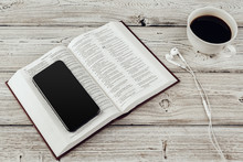Holy Bible And Smartphone With...