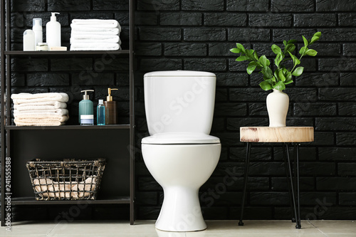 Photo  Modern interior of restroom with ceramic toilet bowl