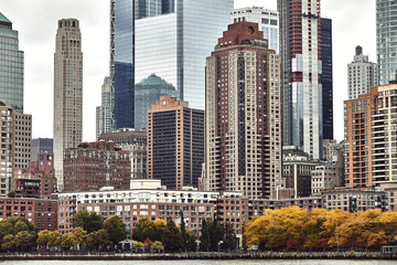 FototapetaNew York city skyline from ferry boat on the ocean, State of Liberty travel
