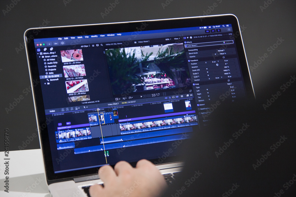 Fototapety, obrazy: Video editing with laptop. Professional editor adding special effects or color grading footage for commercial film or movie.