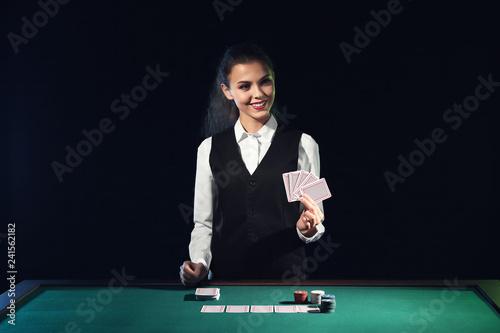 Beautiful female banker at table in casino Poster Mural XXL