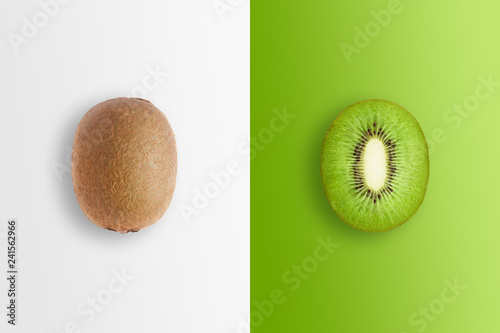 Canvas-taulu Creative background, kiwi and kiwi slices on a white and green background