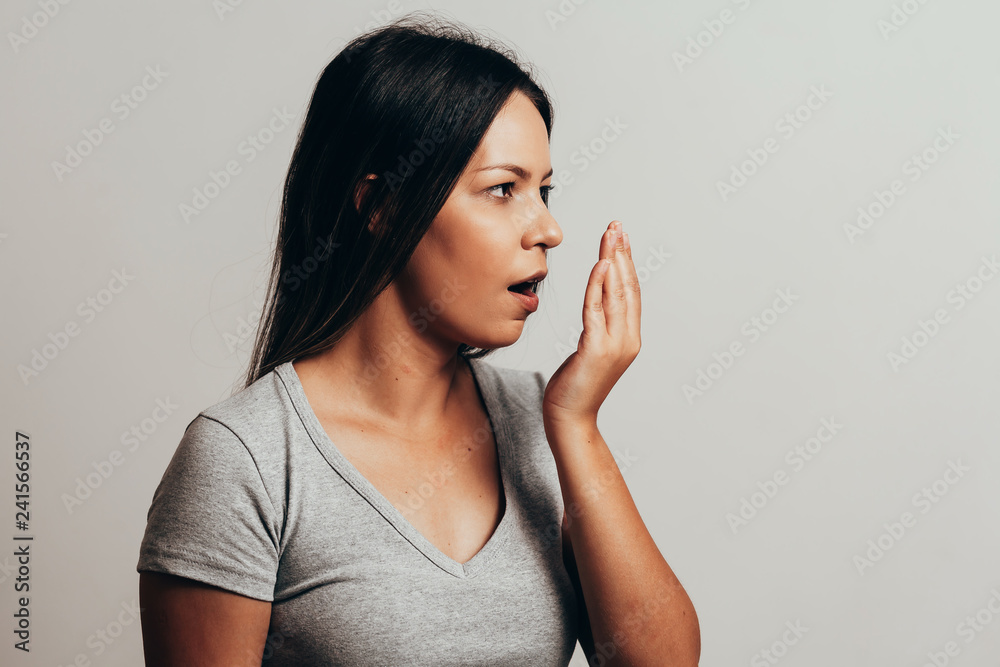Fototapety, obrazy: Bad breath. Halitosis concept. Young woman checking his breath with his hand.