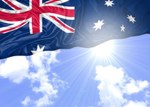 National Flag Of Australia Hoisted Outdoors With Sky In Background. Australia Day Celebration