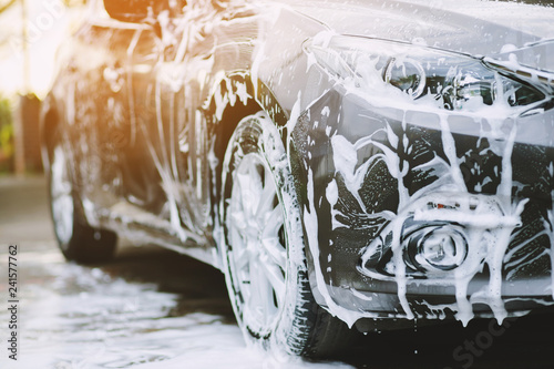 Outdoor car wash with foam soap.	 - 241577762