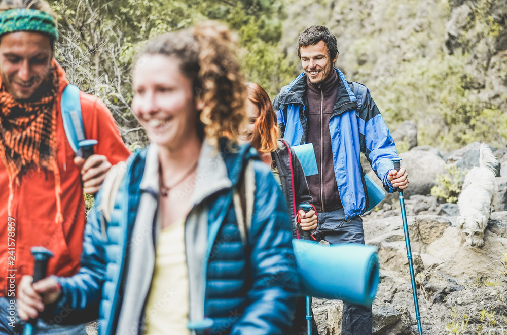 Fototapety, obrazy: Young people doing trekking excursion in mountain's path - Hikers walking in nature path outdoor - Survival,travel and adventure concept - Focus on right man face
