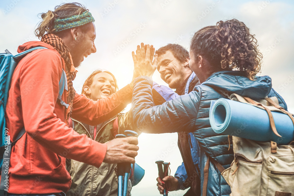Fototapety, obrazy: Group of happy trekkers stacking hands outdoor - Focus on hands