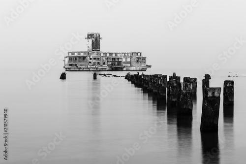 Obraz Old torpedo launcher and breakwater near Gdynia, Poland - fototapety do salonu