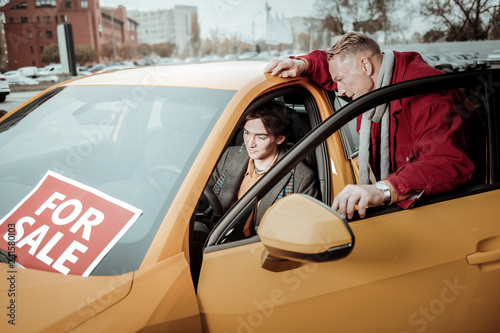 Photo  Generous loving father buying new passenger car for son
