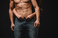 Cropped View Of Girl Hugging Sexy Shirtless Man Isolated On Black