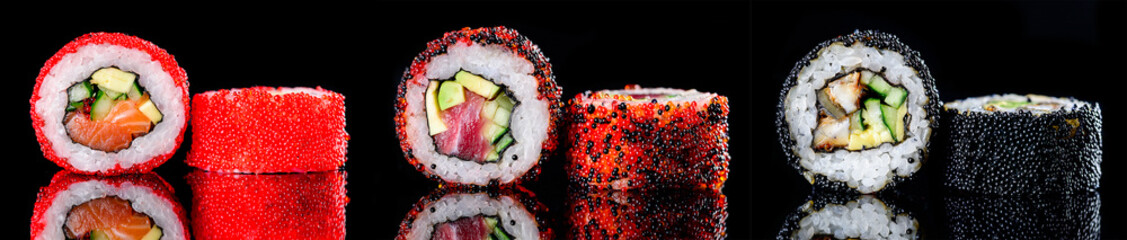 Fototapeta Do gastronomi sushi roll with caviar on a dark background close-up
