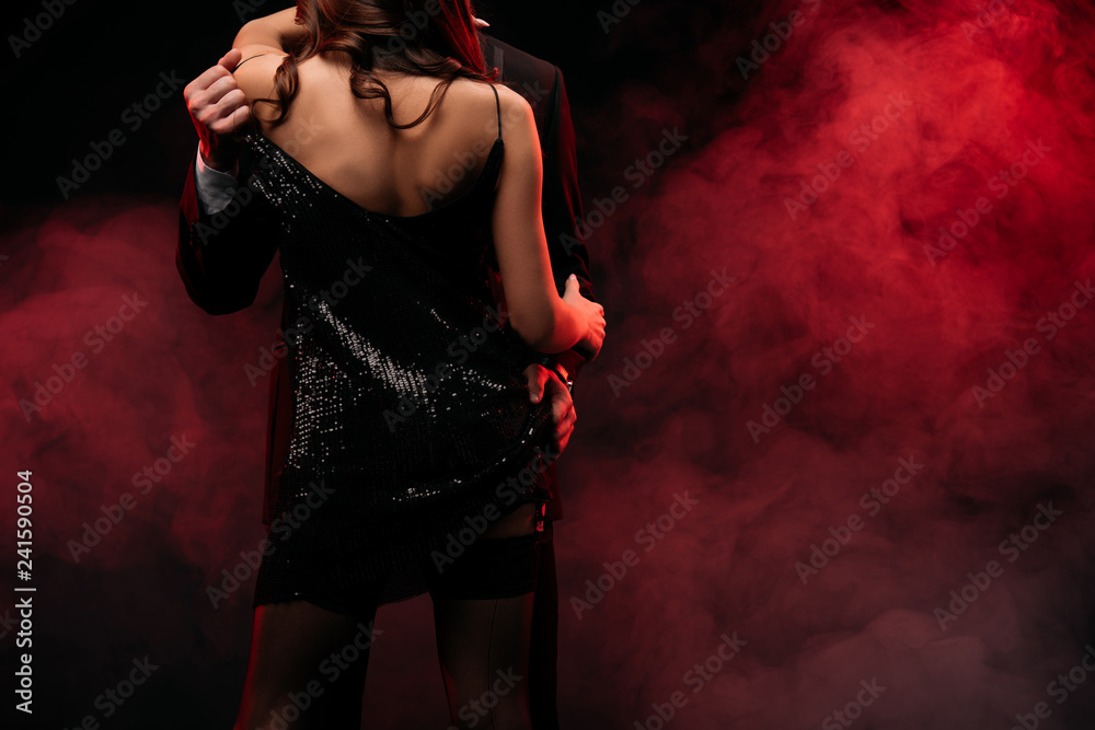 Fototapety, obrazy: back view of sexy couple hugging in red smoky room