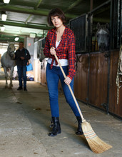 Woman Horse Farm Worker Cleaning Floor