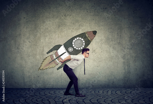 Photo  Smart businessman with rocket