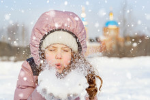 Little Girl Blows Snow With Mi...