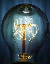 Close Up Of Illuminated Bulb A...