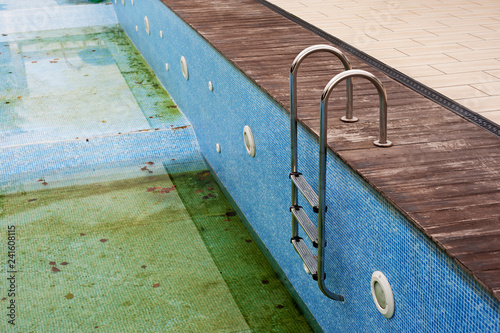 Dirty water in old concrete swimming pool - Buy this stock photo and