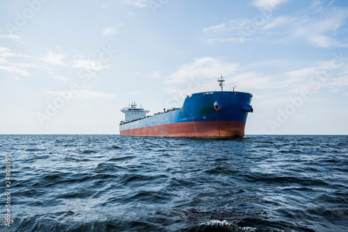 Cargo ship under the cloudy blue sky, Baltic sea, Latvia