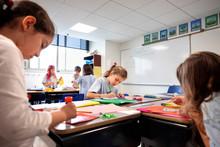 Children Doing Classwork In A Classroom
