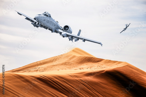 fototapeta na szkło two american warplanes flies over a desert