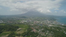 Aerial View City Legazpi In Background Mayon Volcano. Tropical Landscape City Near Volcano On Seashore, Philippines, Luzon.