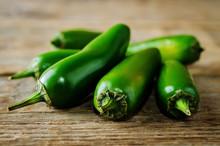 Fresh Jalapeno Peppers On A Da...