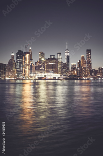 Fototapety, obrazy: New York City skyline at night, color toned picture, USA.