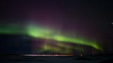 Colorful northern lights over a saskatchewan prairies winter landscape at night